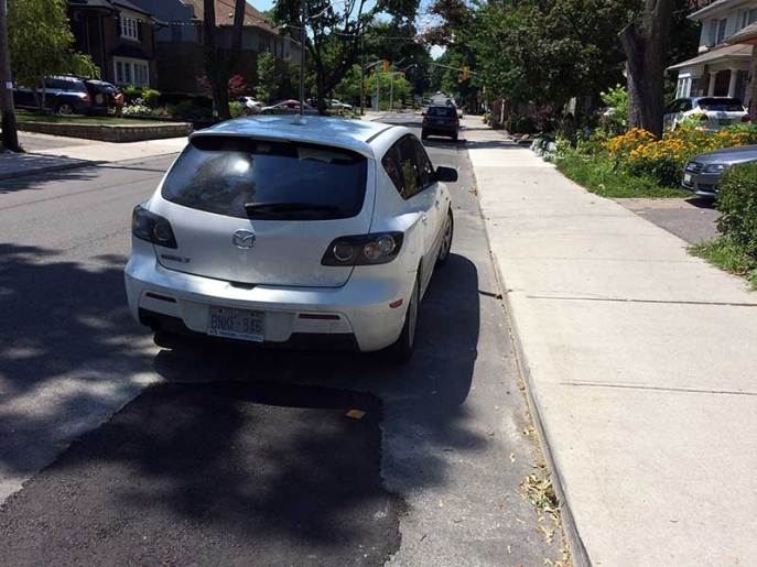 Worst street parking job ever - this car is so far from the curb it doesn't even looked like an attempt to park.